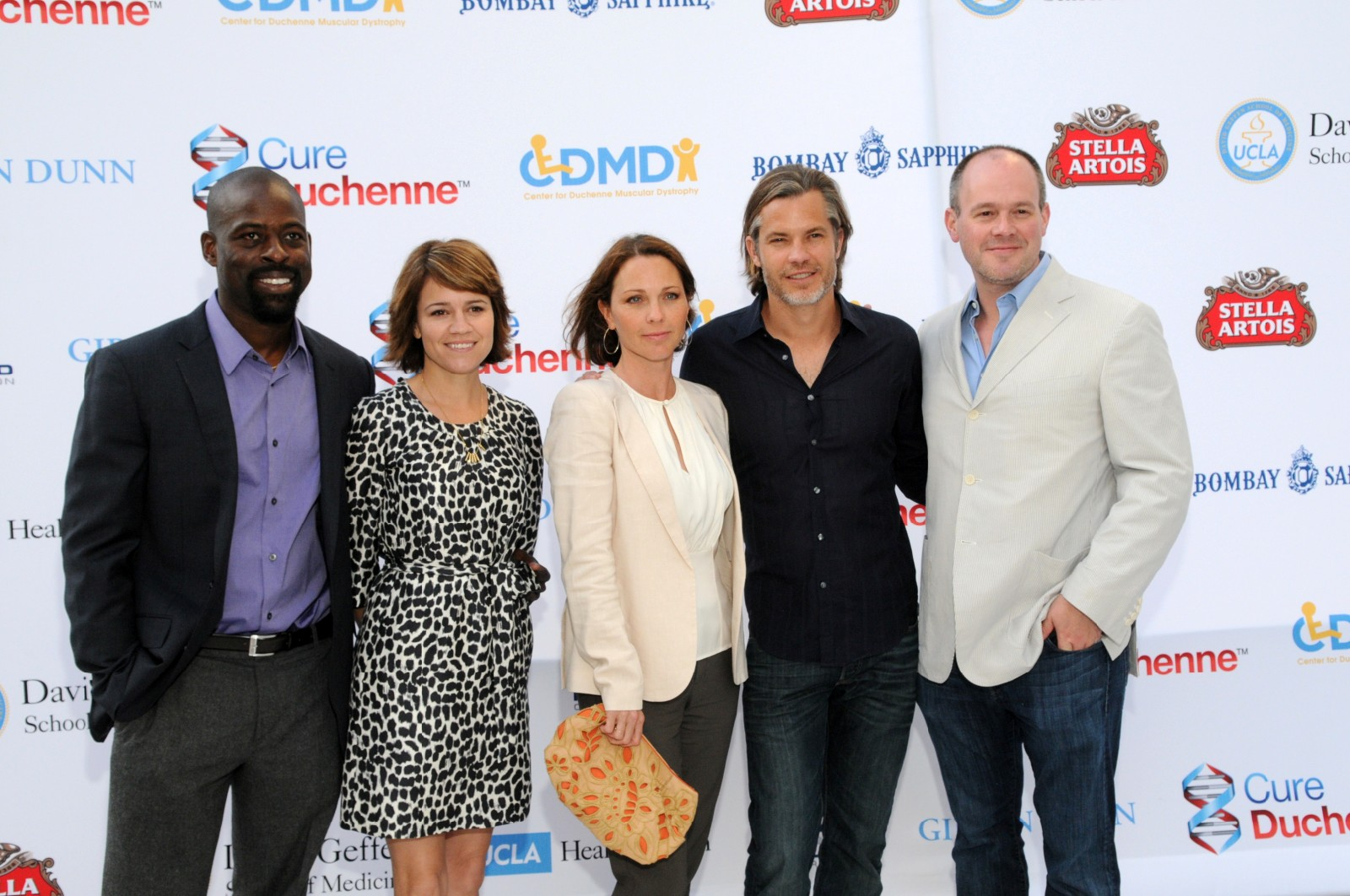 Celebrity poker players arrive on the red carpet. Sterling Brown, Anna Belknap, Kelli Williams, Tim Olyphant, and Rich Eisen