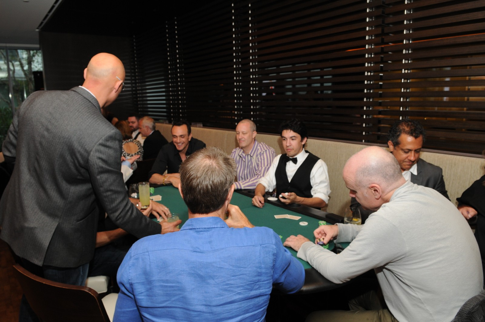 Hank Azaria and guests playing poker